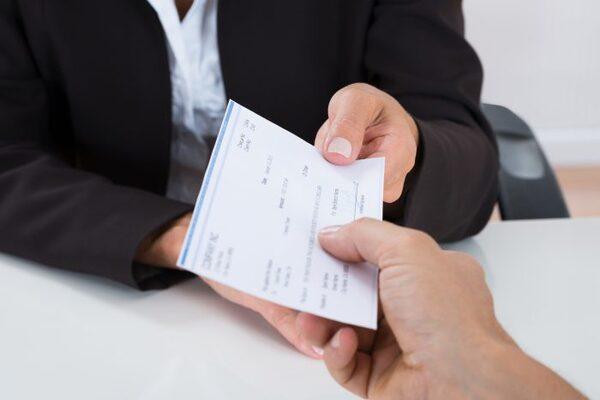 bigstock-Businessperson-Hands-Giving-Ch-107234309-700x467.jpg